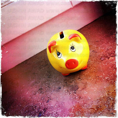 Cute Piggy Bank on a window sill