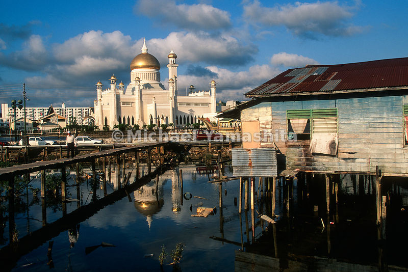 "A ""water town"" house with the Sultan's Palace in the background. .Brunei"