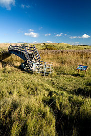 New footbridge crossing the River Kenfig, part of the Wales Coast Path, Kenfig Sands near Port Talbot, South Wales.