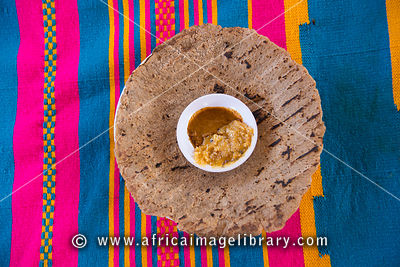 Kocho bread made from the False Banana Tree with honey and chili, Dorze, Ethiopia
