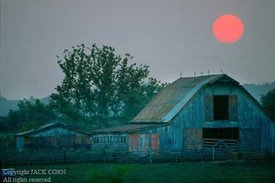 Old barn, red setting sun
