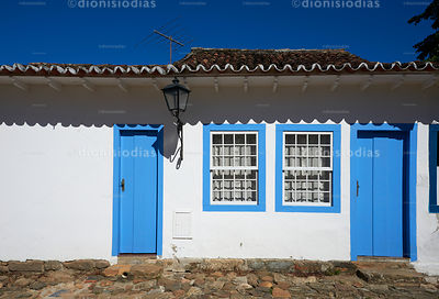 Facade of Colonial House with Doors and Windows in Blue.