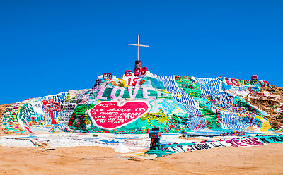 Salvation Mountain is an art installation covering a hill north of Calipatria, California, near Slab City and just a few miles from the Salton Sea.  It is made from adobe, straw, and thousands of gallons of paint.