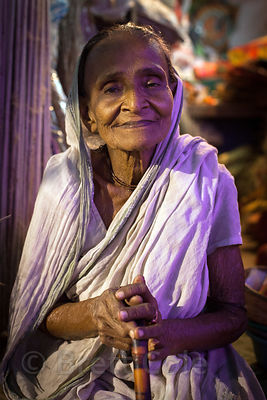 Portrait of an elderly woman at a market in Kalighat, Kolkata, India.