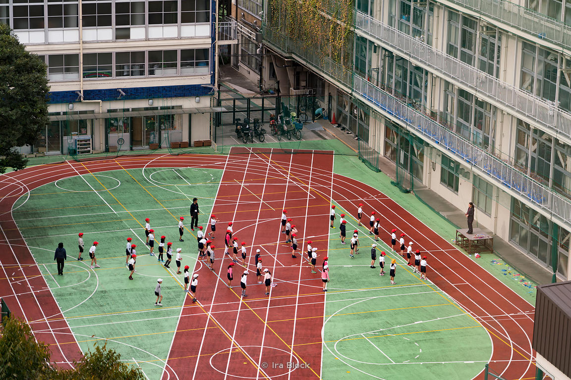 Students at a school yard in Kudanshita neighborhood in Central Tokyo, Japan