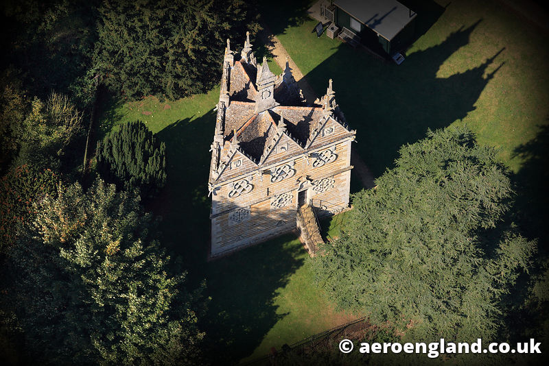 aerial photograph of Rushton Triangular Lodge Northamptonshire. England UK, and Elizebethen Lodge built at the end of the 16th Century