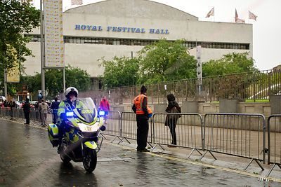 The Royal Festival Hall with Police Motorcycle Passing