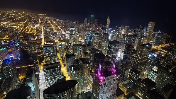 Bird's Eye: Above the Tallest Beacons of Chicago's Dense Skyline at Night