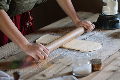 Close-up of woman preparing dough