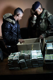 Madagascar Police officers show reporters two boxes containing over 200 millions Ariary (Madagascan currency) in cash (66.000 euros, $74.000) after searching the car of a lawmaker following incidents on June 9, 2015 in Antananarivo. Police arrested overnight Lanto Rakotomanga, a lawmaker hostile to Madagascan President Hery Rajaonarimampianina, after searching her car by force to find the cash, triggering an incident that involved some 20 lawmakers.