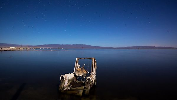 Wide Shot: Artistic Blue Hour Sun Rise Over An Abandoned Armchair & Salton Sea