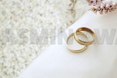 Gold rings on silk with copy space