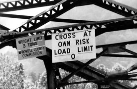 Signs on a bridge in West Virginia