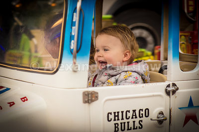 Sheer joy on the face of a child enjoying the funfair