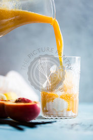 Bright and colorful Ice cream float. Fruit juice being poured.