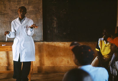 Rwanda - Kibileze - Health educator Theogene Niyongana gives a lecture on HIV and AIDS