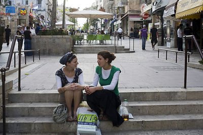 Israel - Jerusalem - Two girls sit and talk on some steps in Ben Yahuda Street,