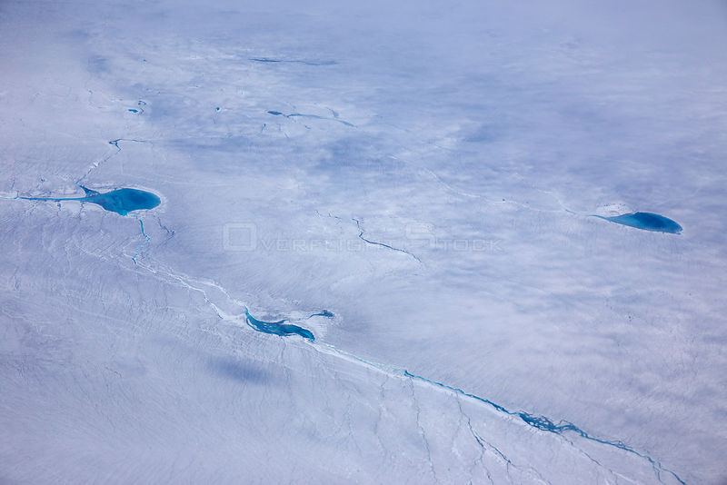Aerial view of meltwater lake on the ice cap east of Kangerlussuaq, Sermersuaq / Greenland ice sheet, Greenland, August 2014..