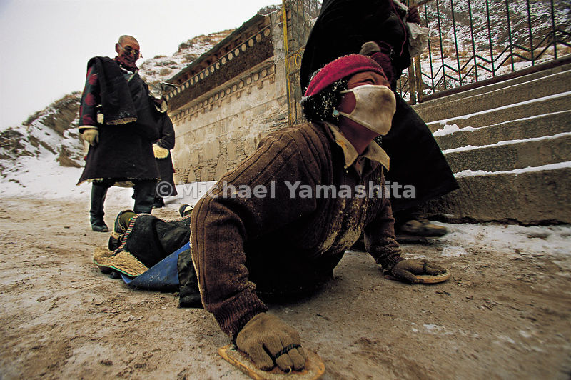 The ciak is probably the most demanding form of pilgrimage in the world. Prostrating themselves fully, worshippers cover tens, sometimes hundreds, of miles. Labrang, Tibet.