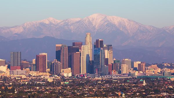 Close Up: A Monumental Sunset Casting A Uniform Shadow Of Darkness Over L.A., Shrouding Snowcapped Peaks, & Finishing In City Lights