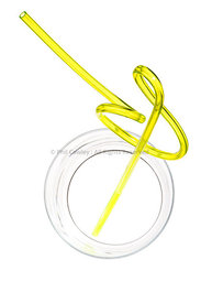 graphic abstract yellow curly drinking straw in an empty glass