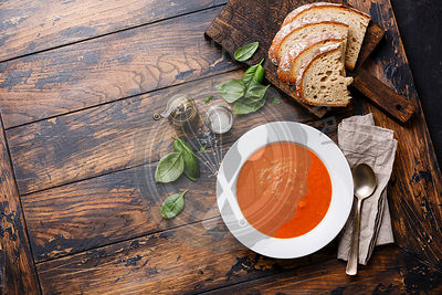 Tomato soup Gazpacho on wooden background Copy space