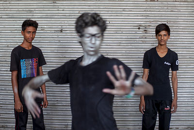 India - New Delhi - Young people in make up perform a street dance on a road blocked to cars in a section of Connaught Place during a Raahgiri Day