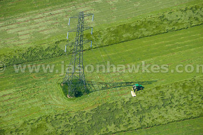 Aerial view of electric pylon in field, Hertfordshire, England