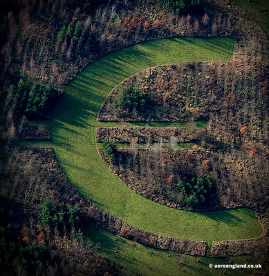 aerial photograph of  a Euro symbol laid out in the landscape and only visible from above.