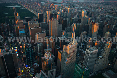 Aerial view of Midtown Manhattan, showing mnay of the impressive skyscrapers including 4 Times Square and the Bank of America Tower