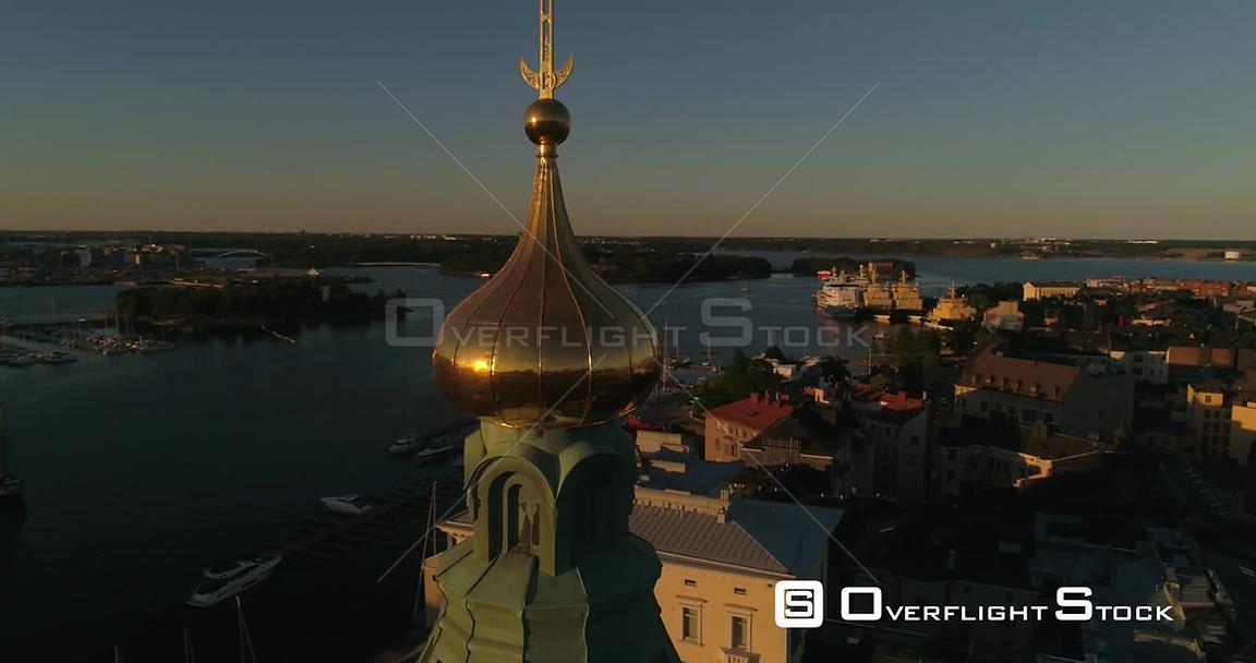 Scandinavian City, Aerial View Around Uspetski Cathedral Golden Cupole, Revealing the City and Helsingin Tuomiokirkko, on a Sunny Summer Evening Dusk, in Helsinki, Uusimaa, Finland