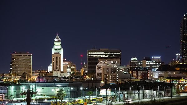 Medium Shot: Angled Pan of China Town & Downtown L.A. Skyline at Night