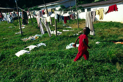 Burundi - Ruyigi - An orphan runs throught the laundry at Shalom House