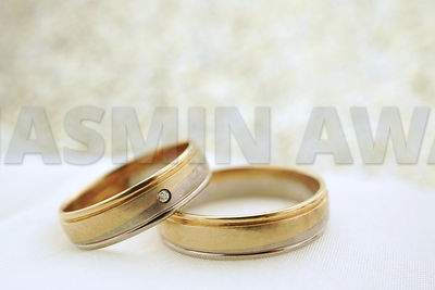Wedding invitation with gold rings and copy space
