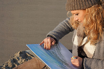 Artist blending and smoothing colors by hand Evening light