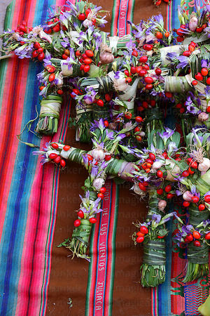Crosses made out of local plants for sale for Easter in market , Cusco , Peru