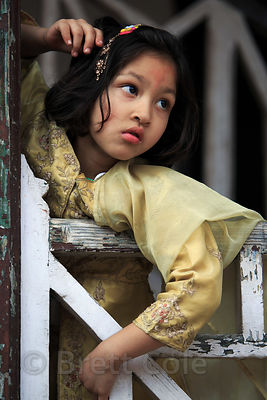 Girl in Kullu, India watching festivities during Dussehra
