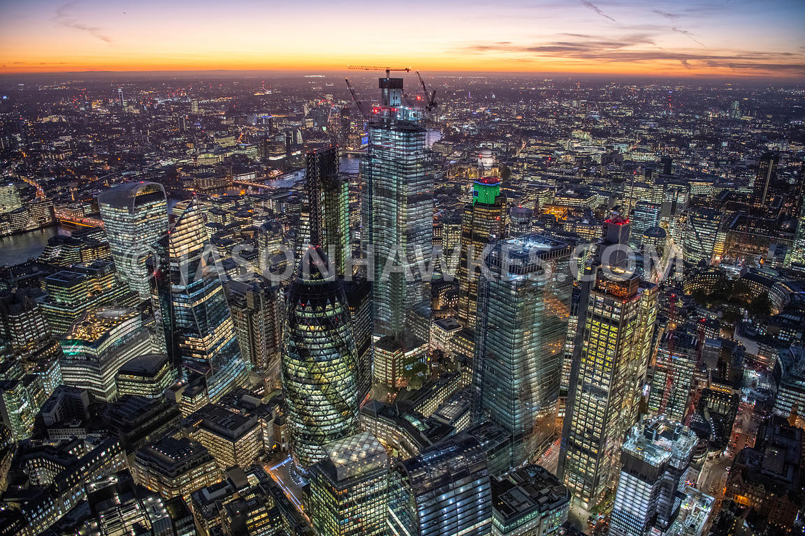 Aerial view of the City of London skyline at dusk/