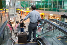 Passengers taking an escalator at Changi Airport, Singapore.