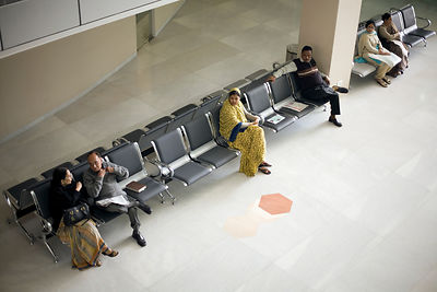 India - Delhi - Patients wait in a waiting area at the Medicity Hospital, Gurgaon
