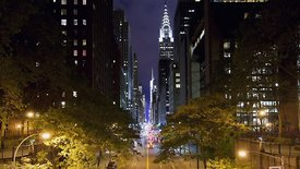 Medium Shot: Night Time Down 42nd Avenue With The Chrysler Building Lit Up