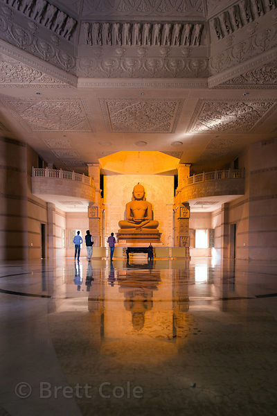 22 foot tall statue of Lord Mahavira in the main chamber of the Nareli Jain temple, Ajmer, Rajasthan, India. The room is amazing, utterly silent except for a mantra echoing quietly on a loop, no people tending to the room, perfectly clean.