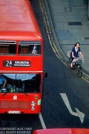 England, Red bus, woman on bicycle