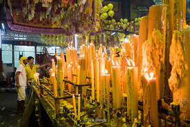 Candle lighting at a temple during the Chinese Vegetarian Festival  in the Chinatown of Bangkok, Thailand.
