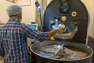 A coffee roaster at Blue Tokai Coffee Shop, Champa Gali, New Delhi
