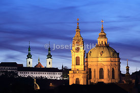 Church of Saint Nicholas on Lesser Town on the right and Strahov Monastery on the left, Prague, Czech Republic