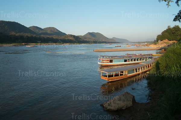 Wooden boats moored on the Mekong river at Luang Prabang