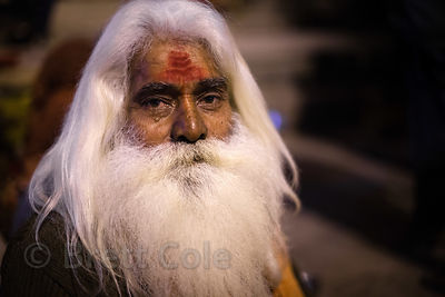 Portrait of an elderly man with a  big white beard near Dashashwamedh Ghat, Varanasi, India.