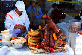 Roast guinea pigs and other ingredients on food stall serving chiri uchu , Cusco , Peru