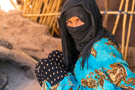 A local in the Erg Chebbi sand dunes in Sahara Desert, Morocco